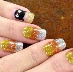 Glitter candy corn nails with a glittery black cat as an accent nail!!! My fav. candy corn mani yet!