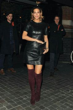 Celebrity in black leather minidress and burgundy OTK boots