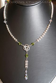 Sterling silver barrel weave lariat necklace centered with Celtic knot, beaded with Swarovski crystals