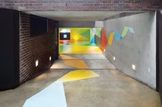 car park in Sydney's Darling Point decked out in a colorful geometric mural by Craig Redman and Karl Maier
