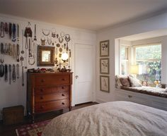 I'm not the first person to suggest using vertical storage opportunities to their fullest in a studio, and I won't be the last! (I LOVE THE WINDOW SEAT!!!)