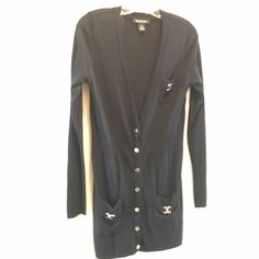 White House Black Market Sweater Awesome long WHBM sweater with silver snap buttons up the front.  Silver hardware has a few scratches but not really noticeable.  Great condition. White House Black Market Sweaters V-Necks