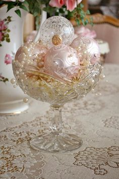antique crystal bowl with pink and ivory ornaments and pearls
