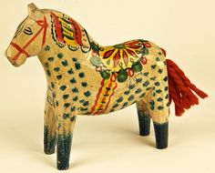 Older Dalahorse of carved wood and with a tail of yarn. Find today's Dala Horses at www.mygrowingtraditions.com