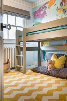 A second child's room with a yellow chevron rug and an elevated bed with a snuggle nook below. The wall behind the bed is an accent wall with a map of the world. Cool Beds For Kids, Cool Kids Bedrooms, Basement Bedrooms, Kids Rooms, Venice House, World Map Mural, Elevated Bed, Wallpaper Decor, Bedroom Wallpaper