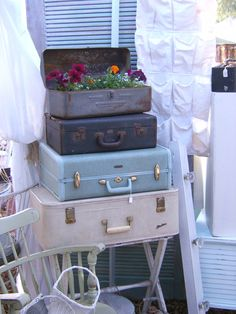 The Vintage Marketplace: Garden Inspirations from previous shows!  suite cases and potted tool box, garden ideas