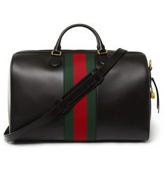 A handsome design by one of Italy's most luxurious houses, this Gucci holdall is crafted from immaculate black leather and sports the brand's iconic red and green 'web' stripe. Perfect for business trips or smart weekends away, this capacious suede-lined style has a wealth of internal and external pockets to keep your personal effects organised. The optional shoulder strap will help to lighten heavy loads.