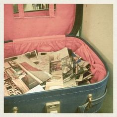 a suitcase full of vintage pictures