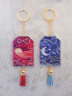 Original charm designs by Miyukiko. Japanese clear acrylic double sided omamori with Sun and Moon motifs, decorated with tassels to suit! Main acrylic charms is roughly - Tracking is not included in the shipping - - Online Store Powered by Storenvy Acrylic Keychains, Acrylic Charms, Resin Charms, Clear Acrylic, Kawaii Jewelry, Magical Jewelry, Cute Keychain, Cute Charms, Pin And Patches