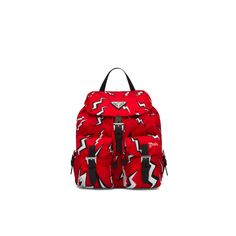 This nylon backpack with adjustable fabric straps and handle is decorated with the Thunderbolt print. The front pockets and flap with buckle closure complete this design with a horror pop mood. Prada Gifts, Triangle Logo, Bowling Bags, Mens Gloves, Cool Backpacks, Prada Shoes, Pet Accessories, Trousers Women, Caps Hats