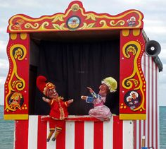 Punch & Judy is a traditional English puppet show based on the earlier Italian commedia dell'arte. It features Mr Punch, who is violent and abusive, interacting with his wife Judy Rachel Thompson, James Ensor, Types Of Puppets, Punch And Judy, Toy Theatre, Puppet Show, Party Entertainment, Childhood Memories, Mall