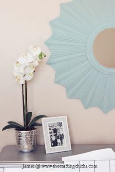 Gorgeous sunburst mirror finished in Duck Egg Blue Chalk Paint® decorative paint by Annie Sloan | By Jamie of The Crafting Chicks