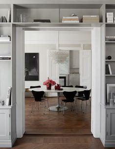 Bookshelf doorway - via Coco Lapine Design blog