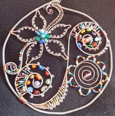 Wire and glass bead suncatcher..