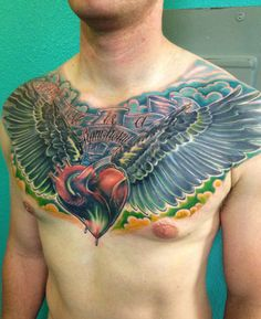 Chest piece tattoo high desert Chris Burnett Evangel Ink Tattoo color tattoo wings and heart