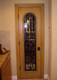 Custom Wine Cellar Door Dallas Texas Wine Cellar Project. This wine cellar project is featured at this page - http://www.winecellarspec.com/custom-wine-cellars-dallas-texas-dann-wine-closet/#. Wine Cellar Specialists  4421 Cedar Elm Circle Richardson, TX 75082  Toll Free: 866-646-7089  Texas Office: 972-454-0480