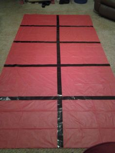 A giant ten frame made out of a plastic tablecloth and black duct tape.  The squares are big enough for kids to stand in to do kinesthetic math in kindergarten.