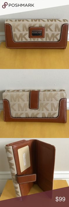 Michael Kors Brookville Carry All Wallet New with tag auth Michael Michael Kors Brookville Carry All wallet in brown/luggage. Flap button closure. On front interior features zip compartment and 2 compartments. On the back snap button closure interior features 12 card slots and 4 compartments. It comes with care card. Michael Kors Bags Wallets