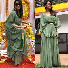 Earthy Goddess Anita Hassanandani looks her ethnic best in Noura By Dipti Sawardekar's latest collection Rustic Rajasthan for the Mehandi function of actress Bharti Singh. Anita was looking stunning in drap high low top with embroider flair pants Pakistani Fashion Party Wear, Indian Fashion Dresses, Dress Indian Style, Indian Designer Outfits, Indian Outfits, Stylish Dress Designs, Designs For Dresses, Lehenga Designs, Designer Kurtis