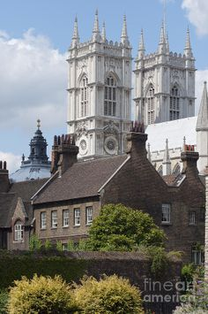 Westminster abbey seen over the rooftops of old Victorian houses. London