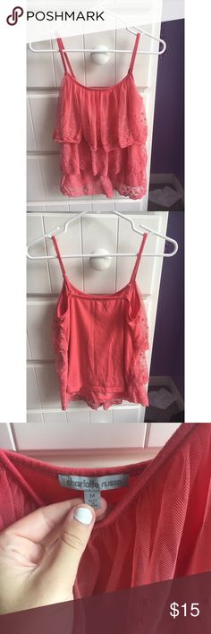 Pink tulle tank, size M, Charlotte Russe Adorable coral pink tulle tank from Charlotte Russe. Worn but in awesome condition. Straps are adjustable. Super flattering style and perfect for summer. Size Medium but I typically wear a small - fits perfectly. Charlotte Russe Tops Tank Tops