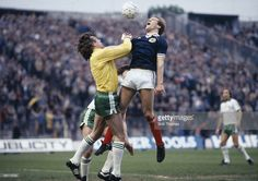Scotland striker Andy Gray challenges Northern Ireland goalkeeper Pat Jennings during the British...