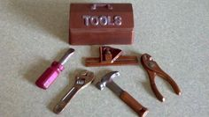 8-12 TOOL BOX, Milk Chocolate Candy Box. Great little box to put that something special in for your someone special, Great to use as a candy or nut cup for the wedding, bridal or baby shower, birthday, team event. Just change your colors. Great to fill with small presents, Jewelry, mints, nuts, candy, gift certificates, Hand painted. You can have your choice of flavor. White, Milk, Mint, Dark, Marbled or Colored Chocolate. Approx 6 OZ, Item # CTB8841 $10.00