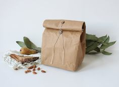 Brown Kraft washable paper lunch bag with natural coconut buttons and waxed cotton twine tie around closure. This type of closure is ideal - easy