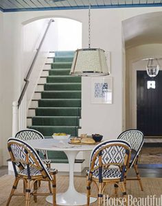 "house's main staircase is off the breakfast area rather than the main entry. ""It leads to the private rooms, so why should it make a public statement?"" says Wolf -- Decorating with Color, Paint, and Patterns - Ann Wolf Home Decorating Ideas - House Beautiful"