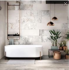 TEXTURE & COLOUR COMBINATION Eclectic concrete look walls and floor & white free standing bath with timber and copper accents.
