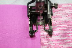 Using a walking foot to stitch in the ditch  You will be able to feel which side of the seam is high with your fingertip. The trick is to REMEMBER TO FEEL FOR IT before sewing the upcoming section of seam.  Then stitch on the lower side as close as possible to where the fabrics are joined.
