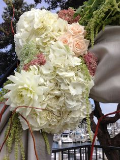 Close Up of Rustic Custom Wedding Arch with Flowers  Flower Box Creative
