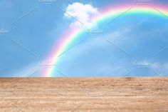 Wood table top on rainbow sky by Pushish Images on @creativemarket