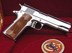 Colt 1911 Polished SS GoldCup