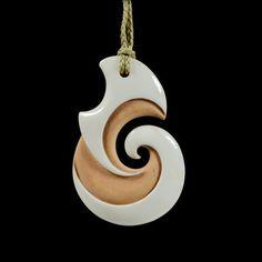 Koru • Fern Frond Pendant by Kerry Kapua Thompson, Māori artist medium = bone tea dyed