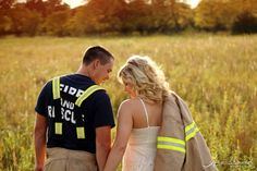 Heartland Photography: {Wichita Engagement Photography} Dani + Devon <--- even bringing a little of the couple to the engagement session - he's a firefighter, so he brought his gear.