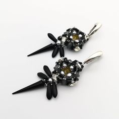 Black earrings with spikes made in the shape of a stylized dragonfly. Very lightweight and touchable. Seed bead jewelry, matte black crystal earrings, spike earrings, goth jewelry