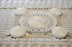 We Make Carpets non-textile carpet installation - giant rug installation made from plastic utensils, cups and containers.