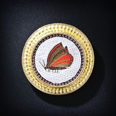 A magnificent and sizable nineteenth-century Italian micro mosaic, depicting a butterfly in repose, has been artfully remounted in a gleaming and substantial handwrought and hand-hammered 19 karat gold frame - the signature karat content of the designer - Elizabeth Locke.
