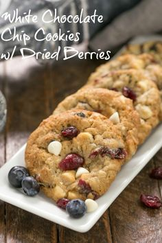 White Chocolate Chip Cookies with Dried Berries - loaded cookies with oats, white chocolate, dried cranberries and blueberries! #whitechocolatecookies #redwhiteandbluecookies #patrioticcookies #berries
