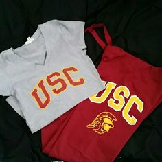 **FINAL**USC sweatpants w/matching V neck top Super cute USC drawstring sweatpants w/matching V neck top.  Brand new, never been worn. Tag says xl but fits more like a medium/large. Non smoking. Pet free home. NWOT Jackets & Coats