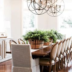 """Who would love to entertain at this table? This """"Traditional But Not"""" dining room post by @asterhousedesign stopped us in our tracks. Not just because of how amazing our dining table looks... •••📸: @reevesphotoco thank you and we are proud to be paired with @leeindustries in this inviting space. #traditionalbutnot #diningtable #dining #madeinusa 🇺🇸❤️ #madeinwv #americanmade #interiordesign #home #homedecor #chandelier #lighting #modernlighting #pullupachair #family #dinnertime…"""