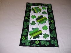 St. Patrick's Day is right around the corner. This is a smaller quilt for a wall or table decoration. It is machine quilted and appliqued. on Etsy, $40.00