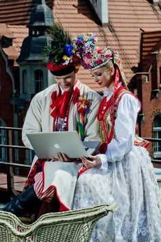 a couple in Polish folklore outfits