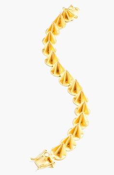 This Eddie Borgo gold cone bracelet is oozing with rock and roll glam!