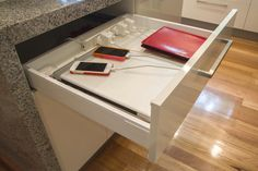 Clever tech drawer to keep phones and laptops charging. www.thekitchendesigncentre.com.au