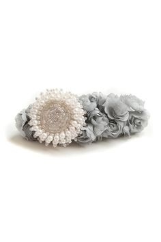 The hair clip barrette made of mesh, featuring pearl embellished sunflower, mesh design to bottom. It makes you sweet and fashion.$21