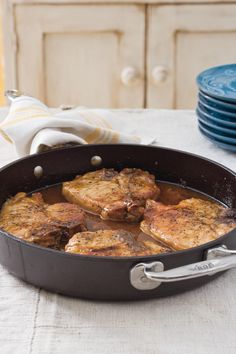 Pork Chops with Pepper Jelly Sauce - Cooking in Your Cast Iron Skillet - Southernliving. The sweet and spicy pepper jelly sauce creates a beautiful glaze on the pork chop and keeps the meat moist and tender.Recipe: Pork Chops with Pepper Jelly Sauce Pork Chop Recipes, Sauce Recipes, Skillet Recipes, Lasagna Recipes, Skillet Cooking, Skillet Dinners, Ham Recipes, Roast Recipes, Bread Recipes