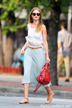 Rosie-Huntington Whiteley in a calf length skirt and crop top combo