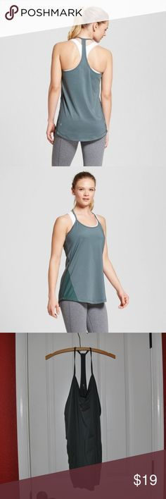 New CHAMPION Pine Green Mesh Piecing Tank Top [C4] Stay cool but keep your style even during the toughest workouts when you're wearing this Tank with Mesh Piecing from C9 Champion. The flowy constructed tank creates a flattering silhouette while still keeping out of the way. The loose-fitting tank top pairs perfectly with leggings and sneakers — lace them up and go!   size XL new without tags color: pine (green)  @cjrose25  More athletic clothes in my posh closet. Bundle your likes for a…